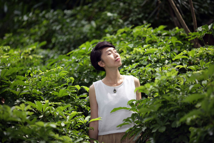 Asian Girl Casual Clothing Day Focus On Foreground Fresh Grass Green Color Green Color Growth Leisure Activity Lifestyles Nature Outdoors Plant Portrait Tree