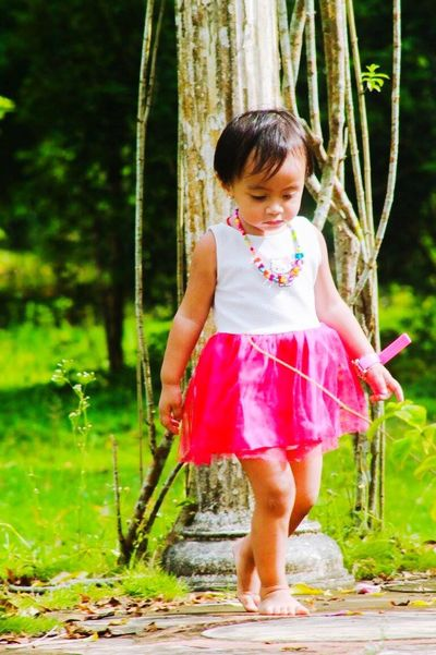 Be. Ready. Full Length One Person Childhood One Girl Only Girls Tree Outdoors Pink Color Barefoot Real People Grass Children Only Day Child People Nature Young Adult Freshness Close-up Happiness
