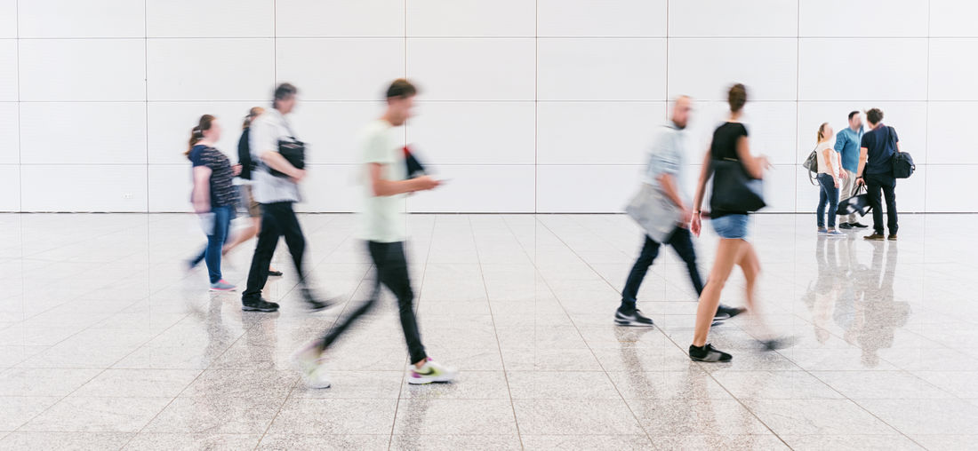 people crowd at an expo hall Anonymous Blurred Business Expo Traveling Adult Airport Blurred Motion Business Finance And Industry Businessman Casual Clothing Crowd Exhibition Future Indoors  Marketing Medium Group Of People Men Motion People Real People Shopping Mall Speed Technology Terminal
