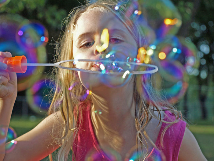 Bright Bubble Wand Colorful Enjoyment Focus On Foreground Girls Headshot Lens Flare Multi Colored Outdoors Party - Social Event Person Selective Focus