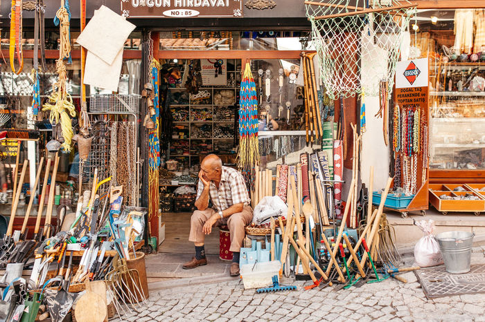 The Shopekeeper Ankara Architecture Building Exterior Built Structure Casual Clothing City Day Full Length Graffiti Leisure Activity Lifestyles Men Person Real People Rear View Retail  Shopkeeper Standing Store Turkey Türkiye Walking