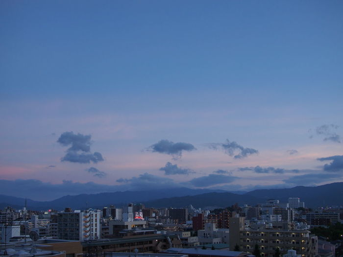View of city against sky during sunset