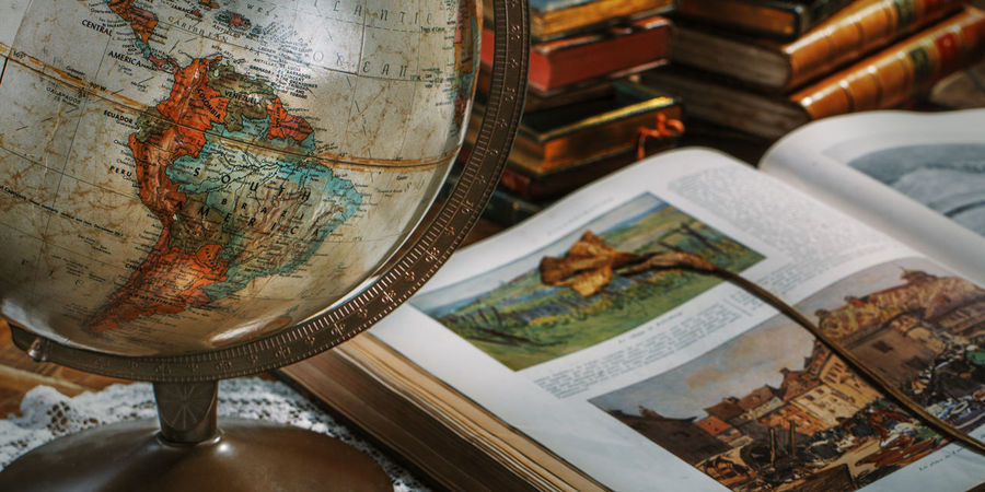 Books Vintage Scene Antique Style Globe Book Close-up Day Dry Flower  Education Exploration Explorer Globe Indoors  Map No People Old Style Globe Travler Treasure Map World