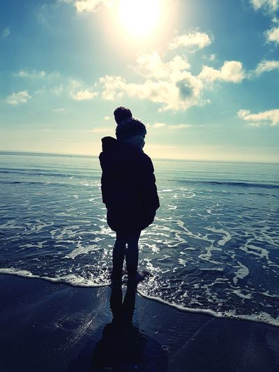 Coastal Contemplation Girl On Beach Child On Beach Waves Child Girl Bobblehat Fresh Thinking Thoughtful Crisp Day Sea Coast Water Sea Full Length Beach Silhouette Standing Sky Horizon Over Water Calm Sandy Beach EyeEmNewHere