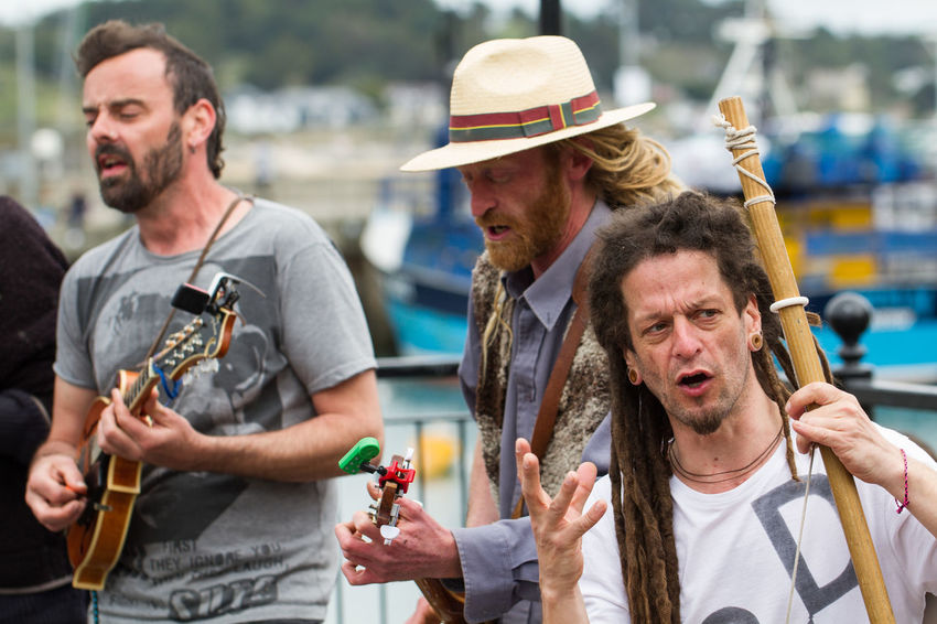 Members of the busking group 'Phat Bollard' singing their political songs on the streets of Padstow in Cornwall, UK. Activists Band Britain Buskers Busking Cornwall Day Dreadlocks Festival Festival Season Group Hippies Instruments Music Musicians Outdoors Padstow People Phat Bollard Political Political Songs Sing Singing Singing My Heart Out Uk An Eye For Travel