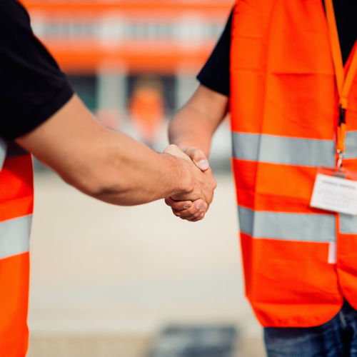 Construction Workers Handshaking Architect Life Business Construction Site Hands Planning Working Caucasian Ethnicity Close-up Construction Industry Construction Worker Cooperation Team Work Day Engineer Handshake Handshaking Human Hand Manager Orange Color Outdoors Professional Occupation Protective Workwear Site Meeting Standing Uniform Young Men