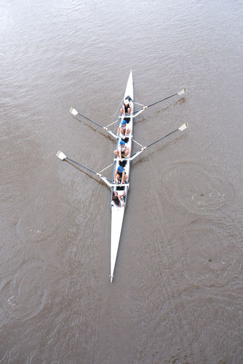 High angle view of people canoeing at lake
