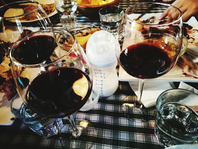 Wineglass Indoors  Wine Drink No People Alcohol Close-up Day Adapted To The City Motherhood Baby Bottle Glasses Friends Eating Together Share The Meal Good Company Table Setting Table Good Friends Being Together Friends And Family Eating This Is Aging This Is Family