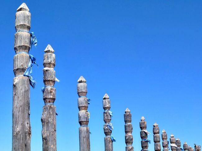 Shamanic place at lake baikal! Am Baikalsee! Wood - Material Blue Sky Holy Place Shamanic Buryatia, Russia, Ulan-Ude Spiritual Russia Siberia Blue Sky Low Angle View Blue In A Row No People Go Higher