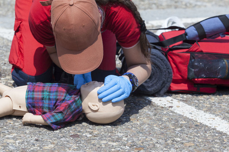 Woman demonstrating emergency rescue for baby toy