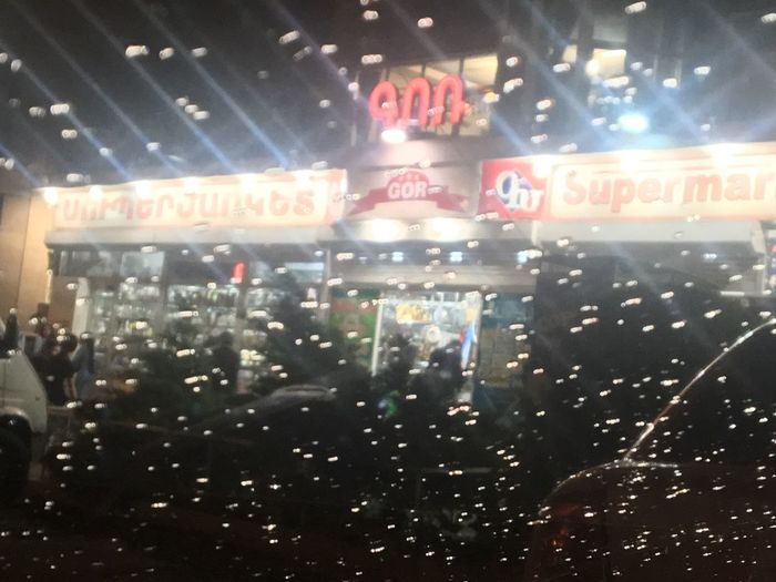 It's a rain in Yerevan Illuminated Night Indoors  Text Transportation Glass - Material Adventures In The City Window Transparent Built Structure Lighting Equipment Nightlife Communication Architecture Mode Of Transportation Western Script Airport Close-up Light Adventures In The City