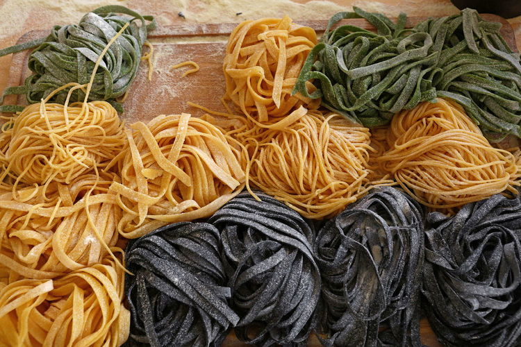 Close-up of raw pasta on table