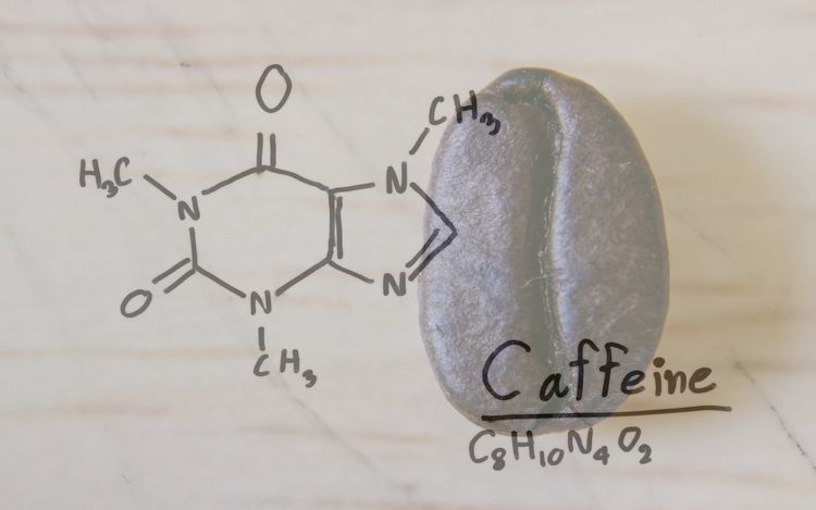 Chemical formula of Caffeine with roasted coffee spill out of cup on white background. Text Western Script Indoors  Communication No People Close-up Still Life Paper White Color Caffeine Addict Caffeine