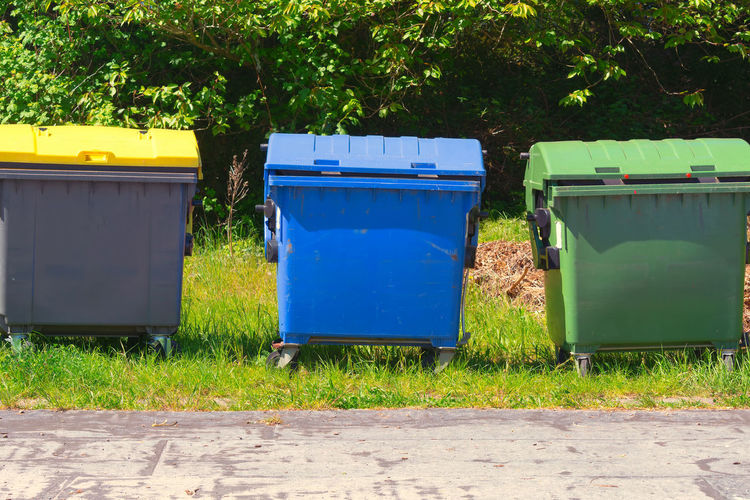 Industrial Waste Containers Dumpster for municipal and private waste Blue Container Day Environment Environmental Conservation Environmental Issues Field Garbage Bin Garbage Can Grass Green Color Growth Hygiene Land Nature No People Outdoors Plant Recycling Recycling Bin Tree