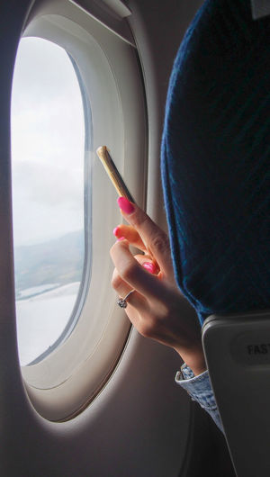 Feel the journey Pink Plane Social Vacations Woman Airplane Device Flying Hand Journey Lifestyles Mobile Phone Passenger Craft Photography Picture Seat Smart Phone Technology Tourism Transportation Travel Window A New Beginning