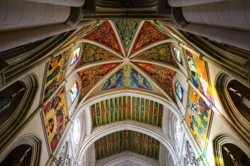 Low angle view of colorful mural ceiling at royal cathedral