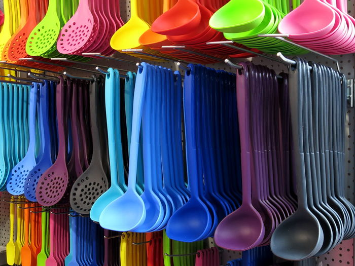 Colorful spoons for sale at market