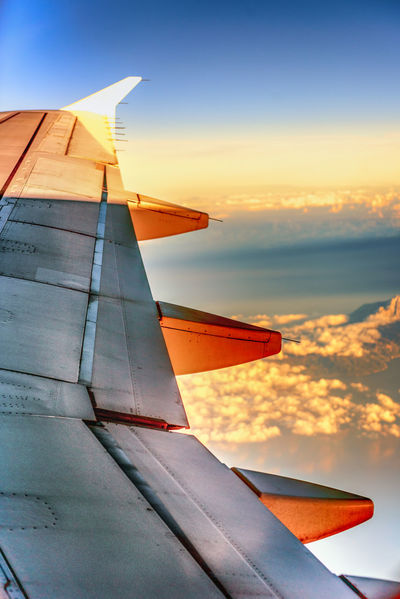 Traveling Air Vehicle Aircraft Wing Airplane Beauty In Nature Cloud - Sky Flying Mode Of Transportation Nature No People Orange Color Outdoors Scenics - Nature Sea Sky Sunlight Sunset Transportation Travel Water