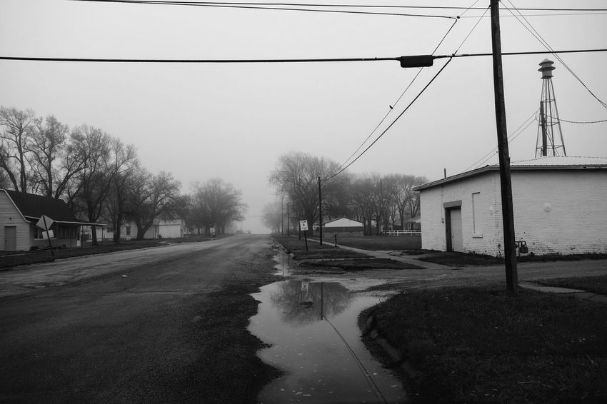Visual Journal May, 2018 Village of Western, Nebraska 35mm Camera B&W Collection Camera Work Composition EyeEm Best Shots FUJIFILM X100S Getty Images Puddleography Rural America Small Town America Visual Journal Always Taking Photos Architecture b&w street photography Building Building Exterior Built Structure Cable City Connection Day Electricity  Electricity Pylon Eye For Photography Fujifilm Fujifilm_xseries Monochrome My Neighborhood Nature No People Outdoors Photo Diary Power Line  Power Supply Rain Road S.ramos May 2018 Schwarzweiß Sky Small Town Small Town Life Telephone Line Transportation Tree Water