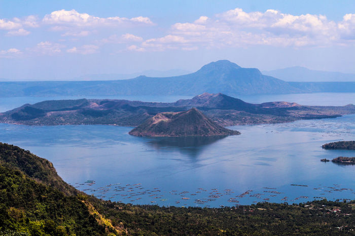 World's smallest active volcano Blue Deadly Taal Volcano EyeemPhilippines EyeEmNewHere Volcano Smallest Active Volcano Nature Beauty In Nature Sky Horizon Over Water Scenics Mountain Tranquility Tranquil Scene Cloud - Sky Outdoors No People Sea Water Landscape