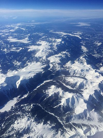 Rocky mountains from the airplane Scenics Beauty In Nature Aerial View Nature Tranquility Tranquil Scene Landscape Physical Geography Snow Sunlight Outdoors Idyllic Environment Day No People The Natural World Sky Winter Mountain Mountain Ridge Mountain Range USA Rocky Mountains Vacation
