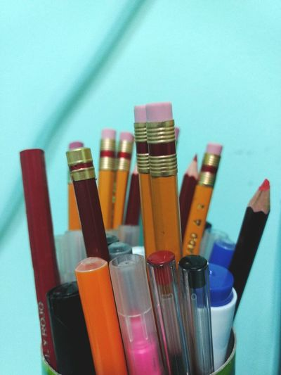Close-Up Of Multi Colored Pencils And Pen