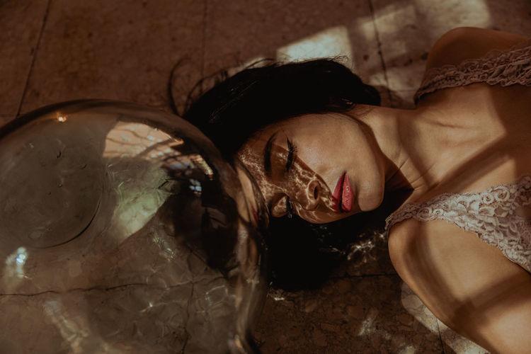 High angle view of woman sleeping