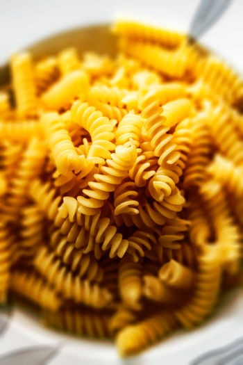 Close-up of pasta Cooking Dinner Food Lunch Macaroni Pasta Carbohydrate Culture Delicious Dry Gold Health Ingredients No Person Noodles Nutrition Penne Spaghetti Traditional Wheat Freshness Close-up Food And Drink Italian Food Indoors  Still Life Yellow No People Selective Focus Indulgence Ready-to-eat Sweet Food Cake Dessert Baked Flower Sweet Temptation Snack