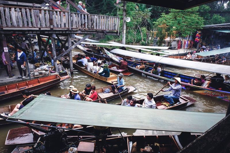 High angle view of people on boat in city