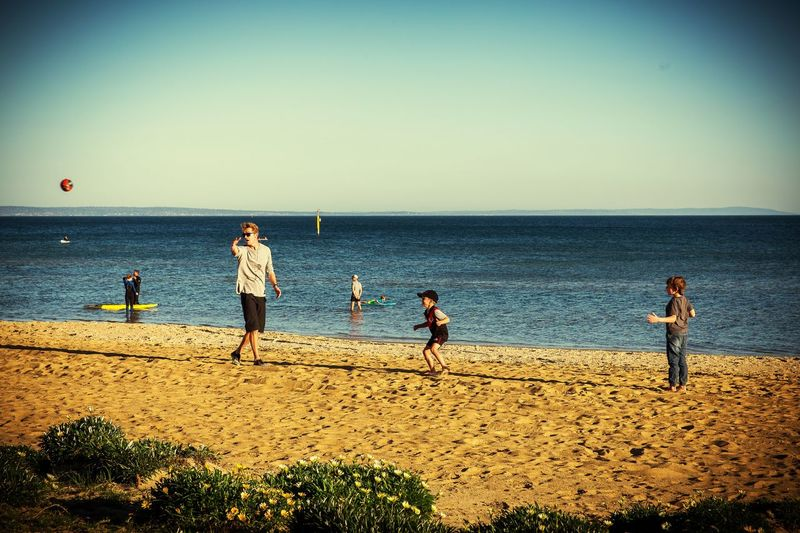 Family footy fun. The Great Outdoors - 2016 EyeEm Awards The Portraitist - 2016 EyeEm Awards Beachside Beach Kids Family Having Fun Happy By The Sea Australia The Street Photographer - 2016 EyeEm Awards Capture The Moment People Of The Oceans The Color Of Sport