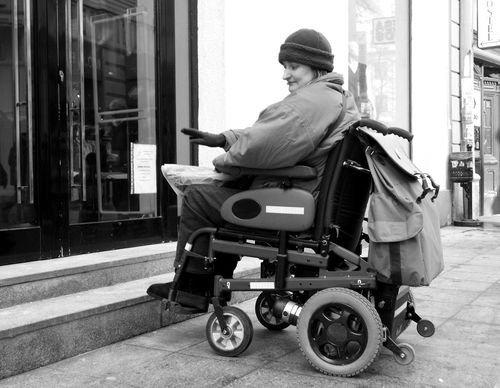 Sarajevo, a wheelchair woman prevented to enter the shop due to the incompetence of the stairs Adult Building Exterior City Day Incompetence One Person Outdoors Real People Sarajevo Side View Sitting Transportation Wheelchair Wheelchair Access