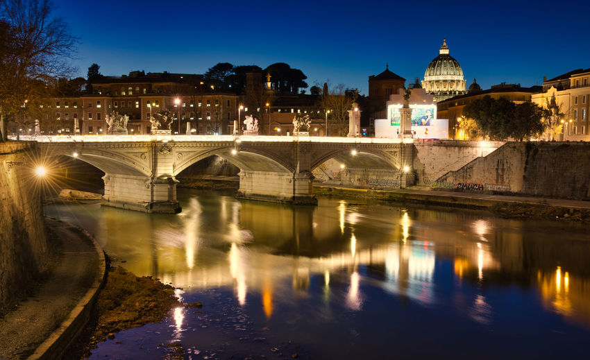 new upload due to watermark. Citylights Rome Italy🇮🇹 Saintpetersbasilica Tiber River Romebynight VaticanCity Nightphotography Bluehourphotography Reflections In The Water City Cityscape Illuminated Water Reflection Architecture