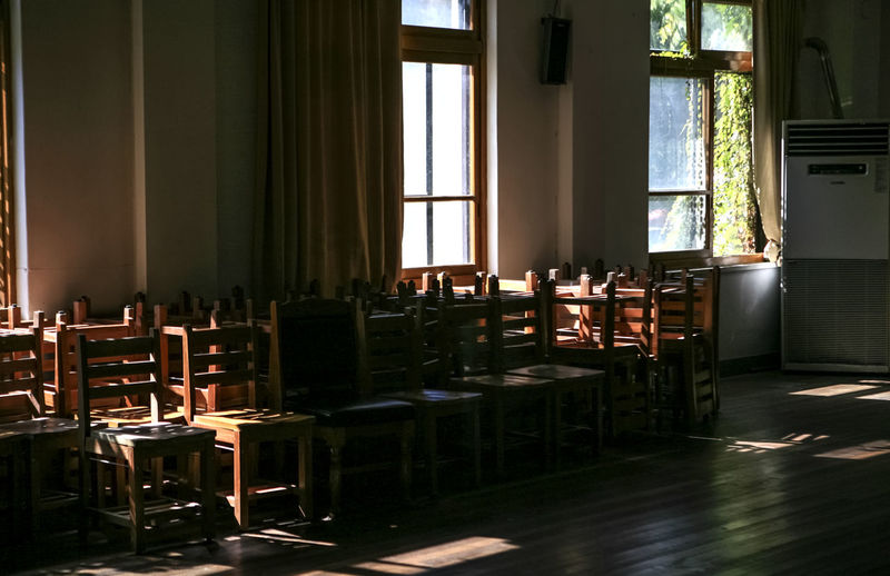 Chairs In Classroom On Sunny Day