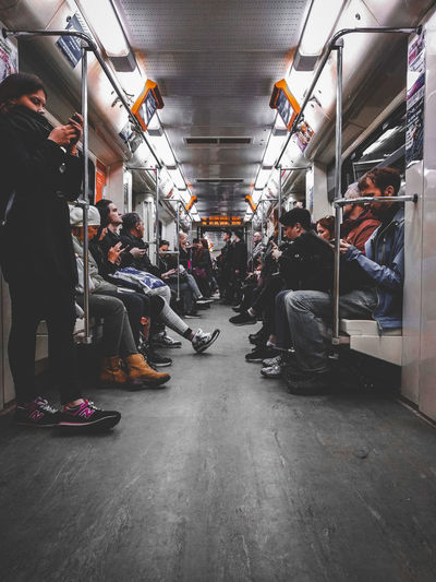 Metro Group Of People Transportation Real People Crowd Mode Of Transportation Men People Women Vehicle Interior Public Transportation Indoors  Adult Rail Transportation Architecture Direction Travel Diminishing Perspective Train Sitting