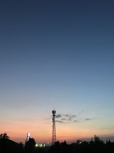 Silhouette tower against sky during sunset