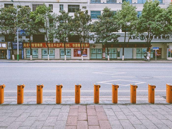 Footpath by street against buildings in city