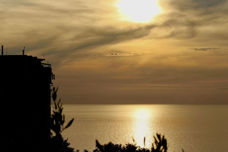 Golden View! Twilight in Cinqueterre Park, Italy. Sunset_collection Beauty In Nature Cloud - Sky Golden Hour Golden Sea Golden View Horizon Over Water Nature No People Outdoors Scenics Sea Silhouette Sky Sunset Tranquility Twilight Sky Water