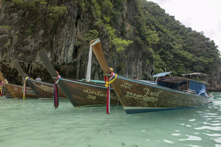 Nautical Vessel Mode Of Transportation Transportation Water Tree Waterfront Nature Day Longtail Boat Moored Beauty In Nature Plant Non-urban Scene Scenics - Nature Sea Outdoors Travel Tranquility Mountain Rowboat Thailand