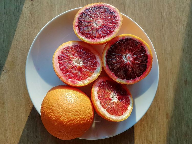 Blood oranges Red Oranges Oranges Calabrian Oranges Calabrian Food Orange Color Bio Fruits Biofood Bio Food Juice Fresh Fruits Fruit Healthy Eating Cross Section Halved Orange - Fruit Freshness Citrus Fruit Close-up Day Healthy Lifestyle Rustic Indoors  No People Food High Angle View Food And Drink Blood Orange SLICE