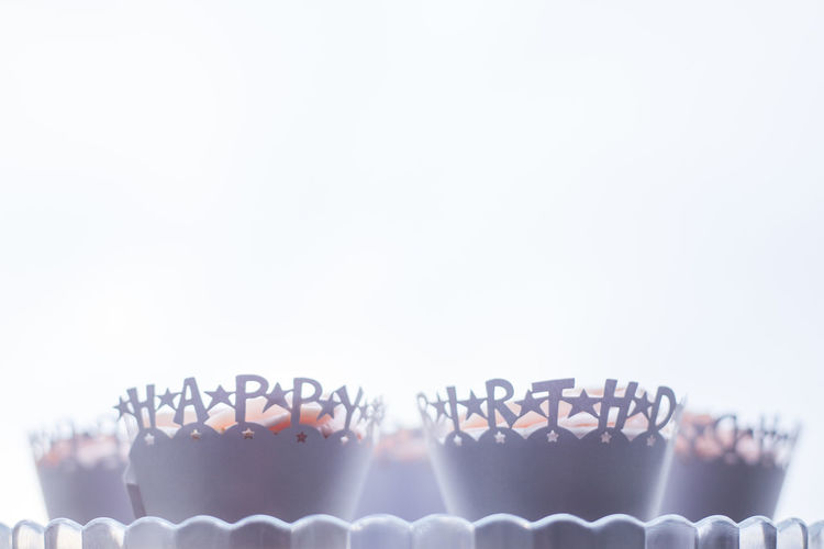 Close-up of candle over white background
