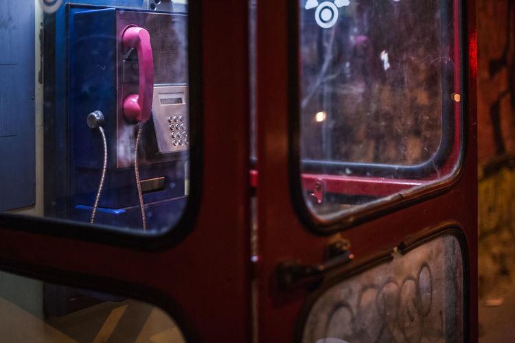 Close-up of telephone on window