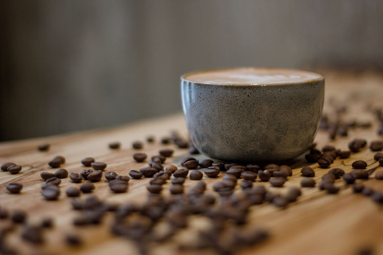 Coffee Coffee - Drink Coffee Cup Coffee Time Coffee Break Food And Drink Indoors  No People Roasted Coffee Bean Food Selective Focus Table Close-up Drink Cup Still Life Freshness Refreshment Mug Spice Coffee Bean Large Group Of Objects Caffeine