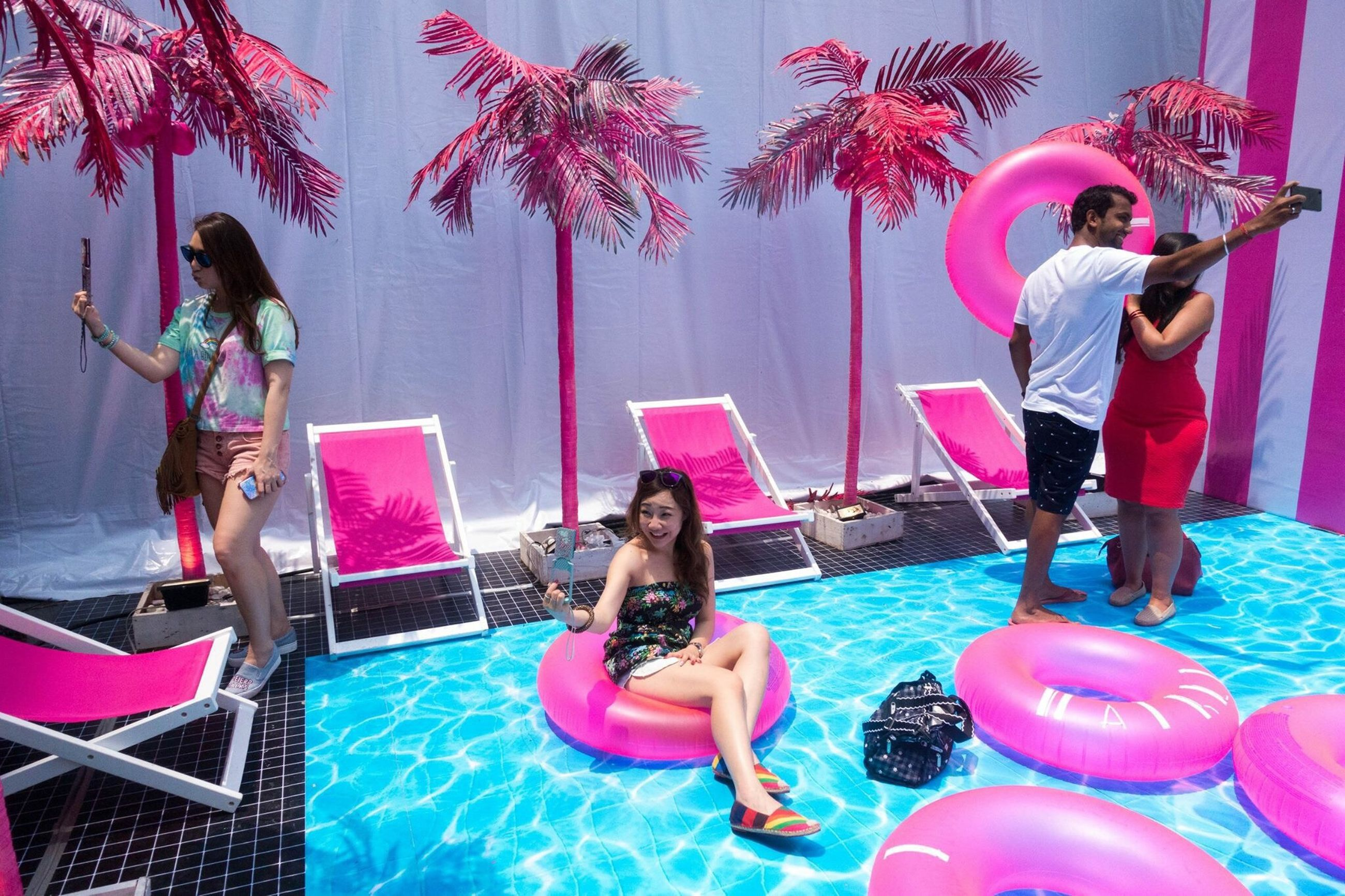 leisure activity, lifestyles, fun, enjoyment, childhood, person, full length, elementary age, happiness, casual clothing, girls, boys, playing, sitting, water, young adult, smiling, arts culture and entertainment