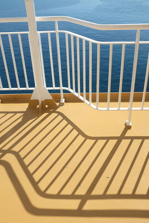 Boat Deck Santorini, Greece Shades Shadow And Light Boat Day No People Outdoors Railing Santorini Sea Shadow Sun Sunlight Water Yellow
