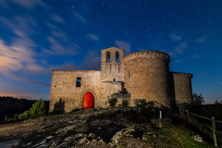 Low angle view of castle against sky at night