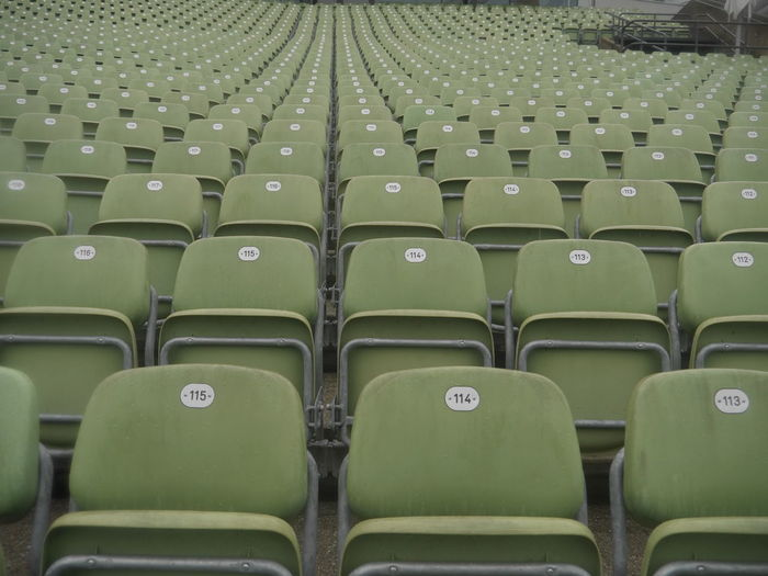 Empty green chairs at stage theater
