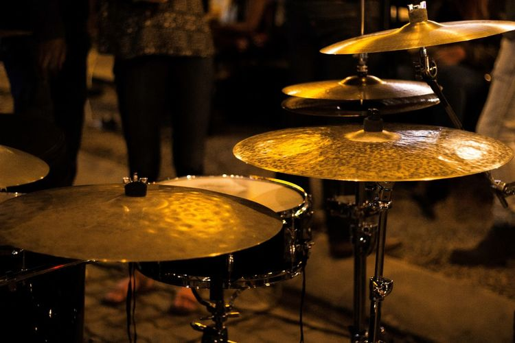 Close-Up Of Drum Kit On Footpath At Night