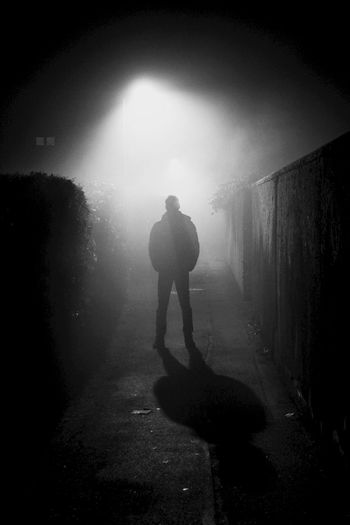 Alone Backlight Black And White EyeEm Best Shots Fog Foggy Gangsters Paradise Last Man Standing Light Light And Shadow Long Exposure Man Midnight Night Shining Light Streetphotography Showcase: January Telling Stories Differently Up Close Street Photography The Street Photographer - 2016 EyeEm Awards Cities At Night People And Places Monochrome Photography Welcome To Black Shades Of Winter Adventures In The City