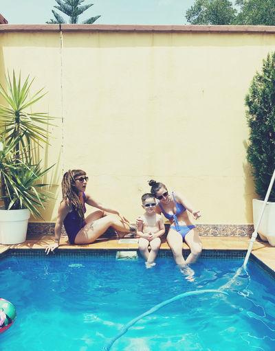 Woman sitting in swimming pool