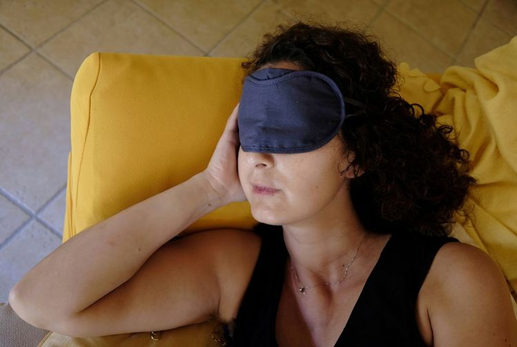 Conceptual Fatigue  Mask For Sleeping Afternoon Rest Nap Young Women Beauty Portrait Beautiful Woman Domestic Life Women Lying Down Curly Hair Bedroom Home Interior Sleeping Bedtime Eyes Closed  Insomnia Napping